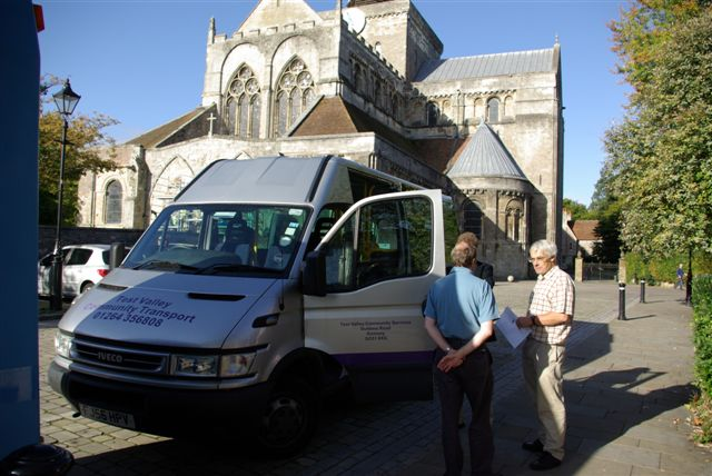 Minibus in front of Romsey Abbey