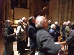 People looking at arches in church