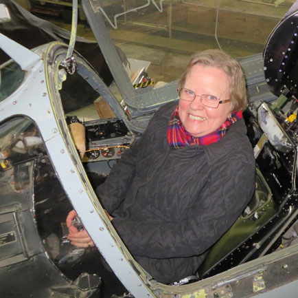 Woman in fighter plane cockpit